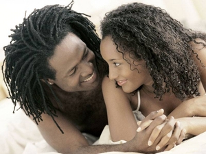 Jamaican couple in bed