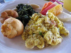 Jamaican breakfast with ackee and saltfish and dumplings