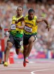 Jamaica's Michael Frater passes the baton to Yohan Blake