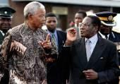 Nelson Mandela and robert mugabe