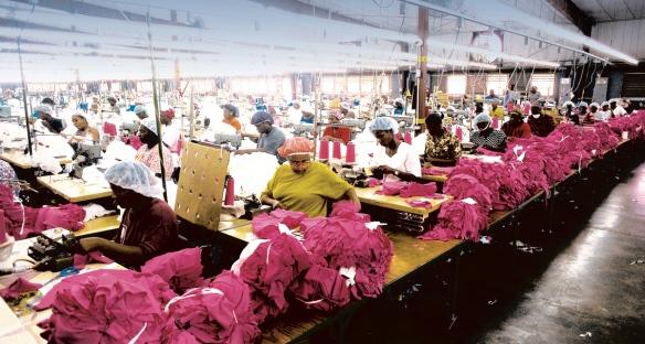 women sewing sweat shop factory