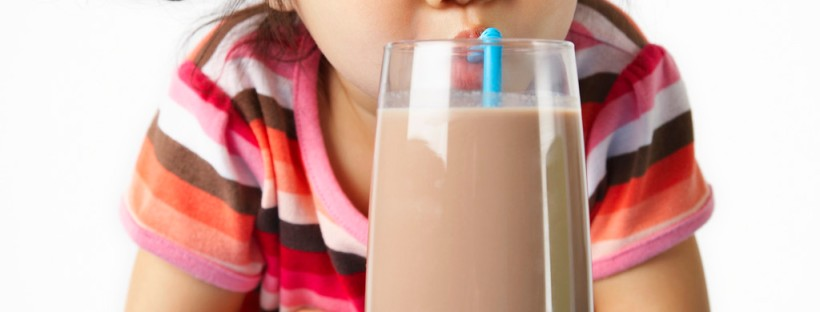 Girl Enjoying Chocolate Milk