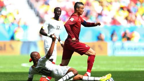 2014 Fifa World Cup - Portugal's Cristiano Ronaldo is tackled by Ghana's Andre Ayew.