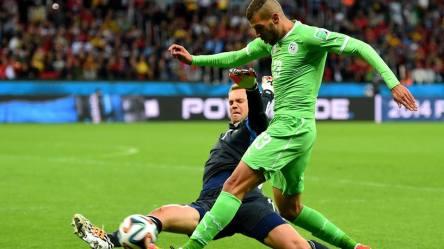 2014 FIFA World Cup - Algeria forward Islam Slimani is tackled by Germany goalkeeper Manuel Neuer.