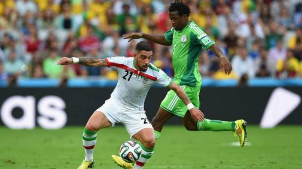 2014 FIFA World Cup - Ashkan Dejagah of Iran controls the ball against Efe Ambrose of Nigeria