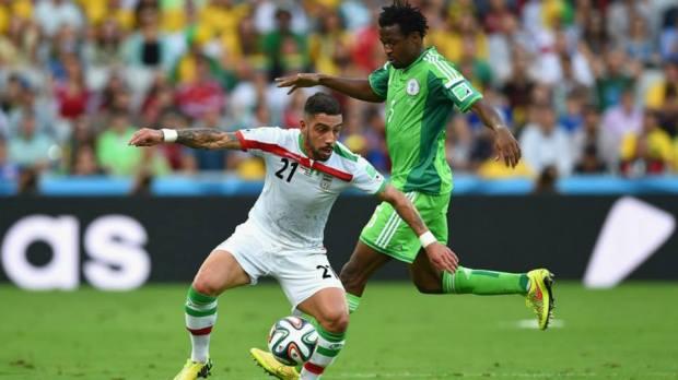 2014 FIFA World Cup - Ashkan Dejagah of Iran controls the ball against Efe Ambrose of Nigeria