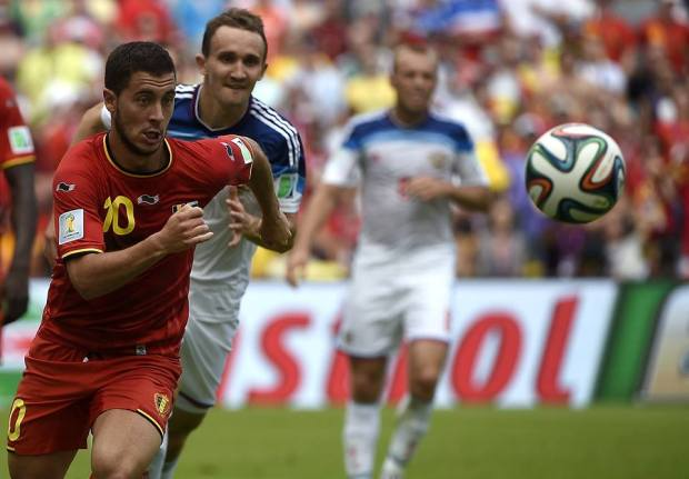 2014 FIFA World Cup - Belgium's Eden Hazard (L) vies for the ball with Russia's defender Aleksei Kozlov.