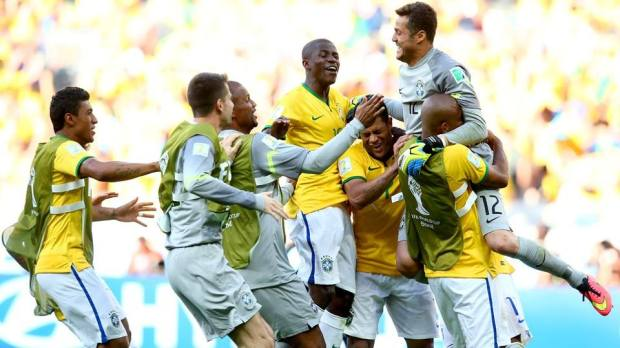 2014 FIFA World Cup - Brazil celebrate winning on penalties and advancing to the quarter-finals.