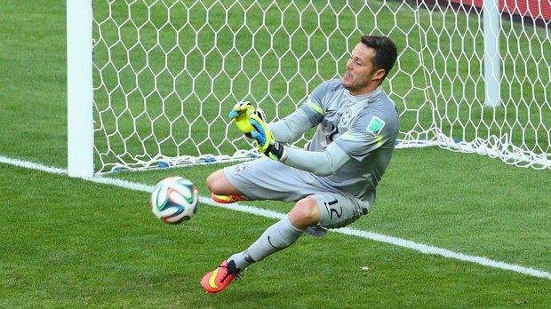 2014 FIFA World Cup - Brazil goalkeeper Julio Cesar saves Chile forward Mauricio Pinilla's penalty kick.