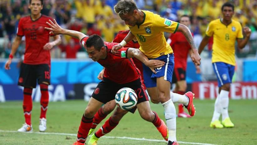 2014 FIFA World Cup - Brazil's Neymar battles for the ball with Aguilar