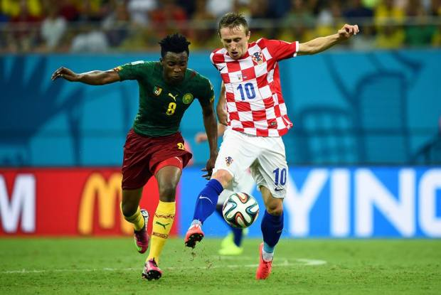 2014 FIFA World Cup - Cameroon midfielder Benjamin Moukandjo views for the ball with Croatia midfielder Luka Modric.