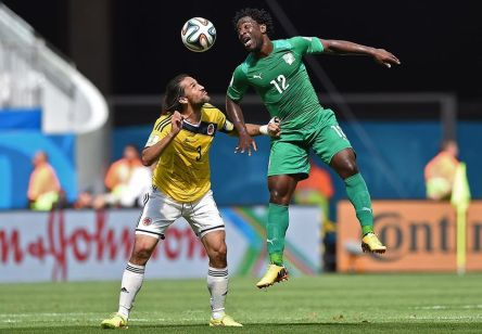 Côte d'Ivoire forward Wilfried Bony challenges Colombia captain Mario Yepes for the ball - Colombia 0 vs. 0 Cote d'Ivoire