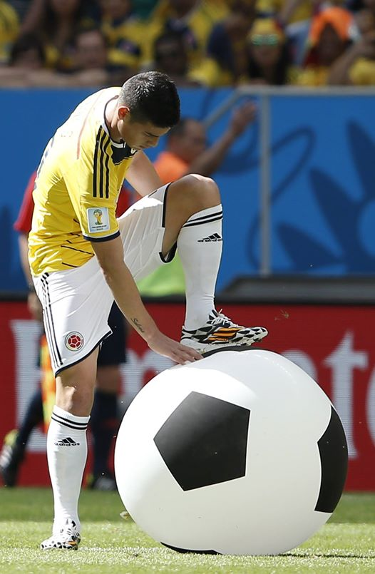 Colombia 0 vs. 0 Cote d'Ivoire - Colombia's James Rodriguez deflates an inflatable football.