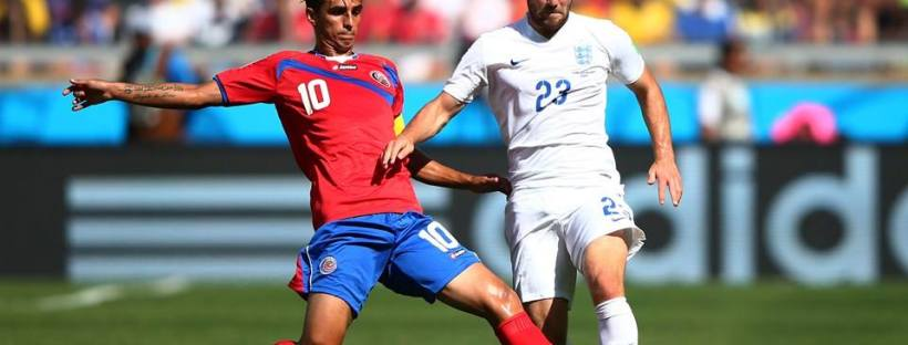 2014 FIFA World Cup - Costa Rica captain Bryan Ruiz makes a challenge on England defender Luke Shaw.