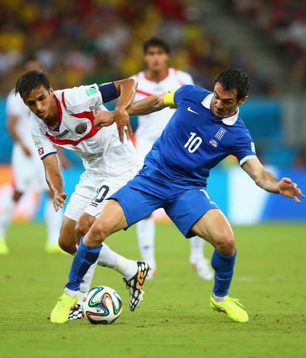 2014 FIFA World Cup - Costa Rica's Bryan Ruiz of Costa Rica tries to win the ball from Greece's Giorgos Karagounis.