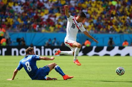 Costa Rica's Cristian Gamboa hops over Italy midfielder Claudio Marchisio. - Italy 0-1 Costa Rica