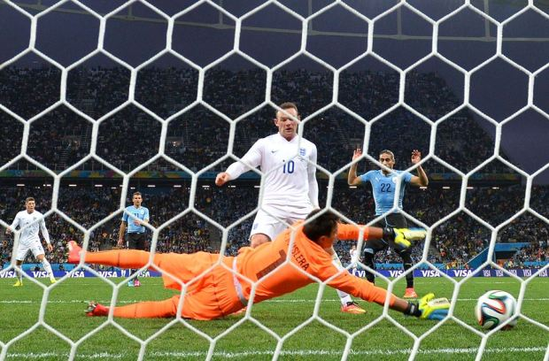 2014 FIFA World Cup - England's Rooney's goal was his first in a World Cup.