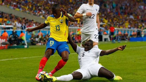 2014 FIFA World Cup - France defender Mamadou Sakho tackles Ecuador forward Enner Valencia.