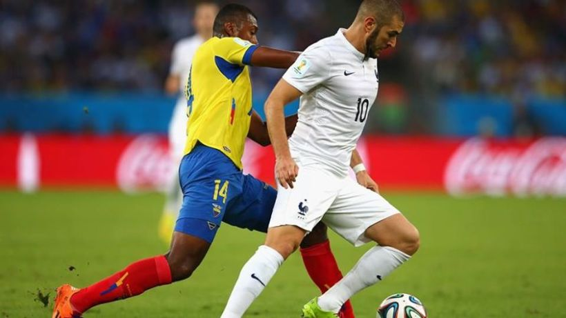 2014 FIFA World Cup - France forward Karim Benzema dribbles away from Ecuador's Oswaldo Minda.
