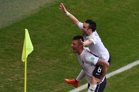 France midfielder Mathieu Valbuena celebrates with forward Olivier Giroud after scoring the third goal. - Switzerland 0-3 France