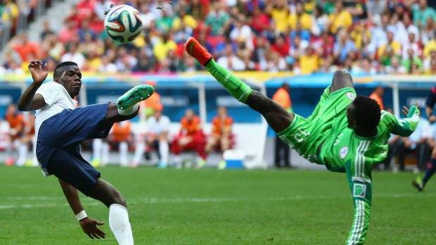 2014 FIFA World Cup - France's Pogba and Nigeria's Juwon Oshaniwa compete for the ball in acrobatic fashion.