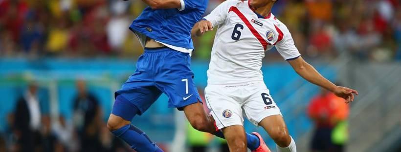 2014 FIFA World Cup - Giorgos Samaras of Greece controls the ball against Oscar Duarte of Costa Rica.