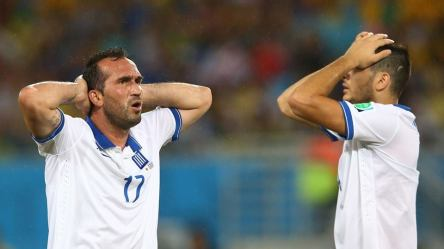 2014 FIFA World Cup - Greece's Theofanis Gekas and Konstantinos Manolas react after a missed chance in rainy Natal.