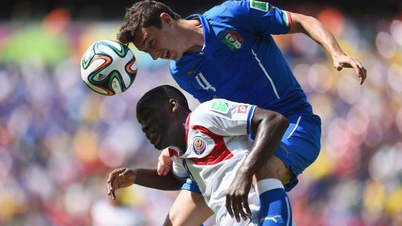 Italy defender Matteo Darmian challenges Costa Rica forward Joel Campbell for the ball - Italy 0-1 Costa Rica