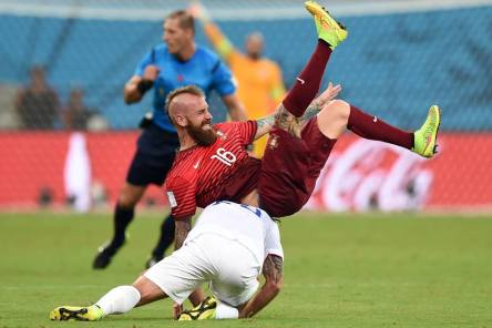 2014 FIFA World Cup - Kyle Beckerman of the United States tackles Raul Meireles of Portugal during the 2014 FIFA World Cup Brazil