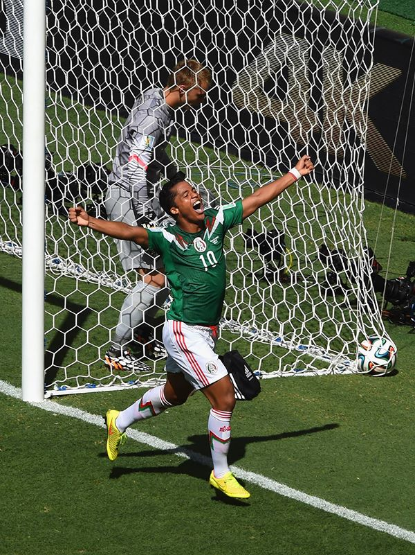 2014 FIFA World Cup - Mexico's Giovani dos Santos celebrates scoring the opening goal against the Netherlands