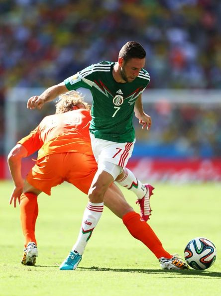 2014 FIFA World Cup - Netherlands' Dirk Kuyt challenges Miguel Layun of Mexico.