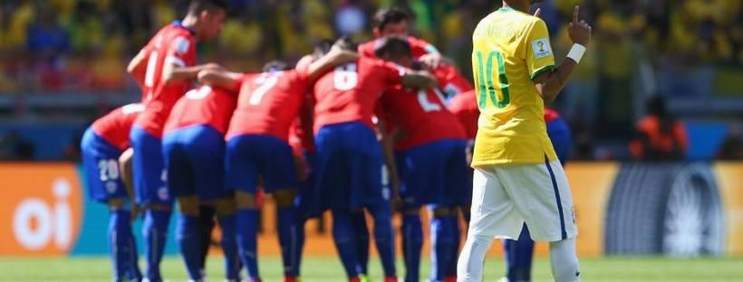 2014 FIFA World Cup - Neymar prays while Chile huddle.