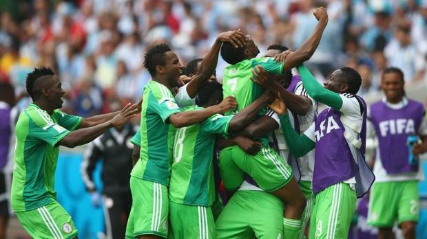 2014 FIFA World Cup - Nigeria celebrate their second goal in Porto Alegre.