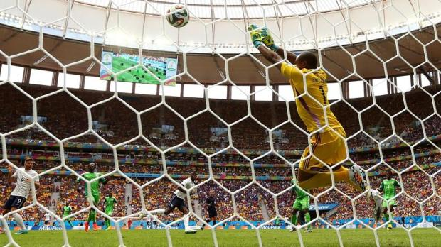 2014 FIFA World Cup - Nigeria goalkeeper Vincent Enyeama saves a shot by Paul Pogba of France.