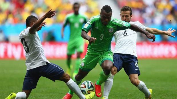 2014 FIFA World Cup - Nigeria's Emmanuel Emenike is challenged by France's Patrice Evra and Yohan Cabaye.