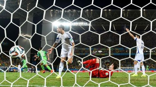 Peter Odemwingie of Nigeria scores his team's first goal past Asmir Begovic of Bosnia and Herzegovina during the 2014 FIFA World Cup