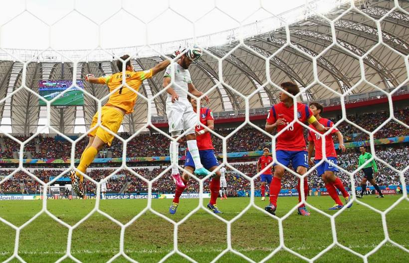 2014 FIFA World Cup - Rafik Halliche (2nd L) of Algeria scores his team's second goal beating Jung Sung-Ryong (1st L) of South Korea