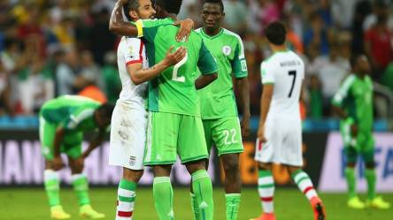 2014 FIFA World Cup - Reza Ghoochannejhad of Iran hugs Joseph Yobo