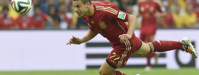 Spain defender Cesar Azpilicueta attemps a diving header in Rio de Janeiro - Spain 0 vs. 2 Chile