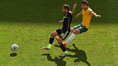 2014 FIFA World Cup - Spain defender Jordi Alba vies for the ball with Australia's Mathew Leckie.