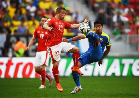 Switzerland winger Xherdan Shaqiri vies for the ball