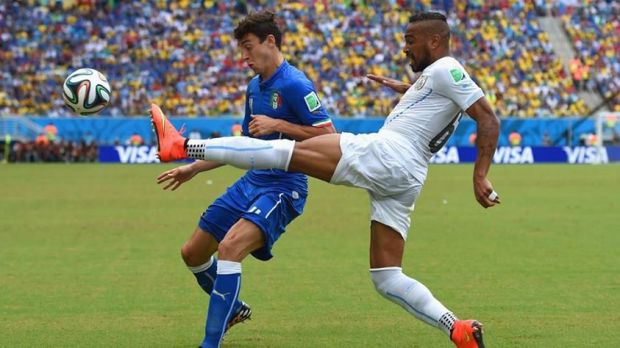 2014 FIFA World Cup - Uruguay's Alvaro Pereira vies for the ball with Italy's Matteo Darmian.