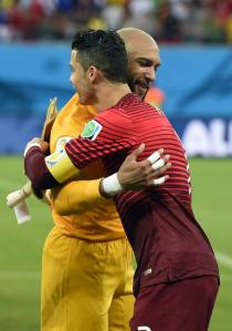 2014 FIFA World Cup - US goalkeeper Tim Howard (L) hugs Portugal's forward Cristiano Ronaldo