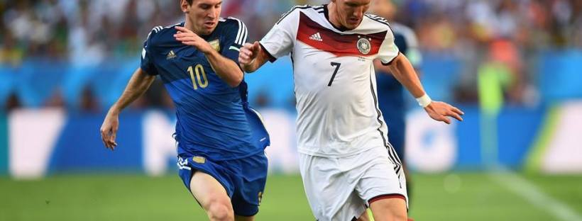 2014 FIFA World Cup - Argentina captain Lionel Messi and Germany midfielder Bastian Schweinsteiger vie for the ball.