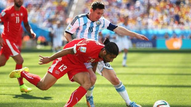 2014 FIFA World Cup - Argentina captain Lionel Messi challenges Switzerland's Ricardo Rodriguez.