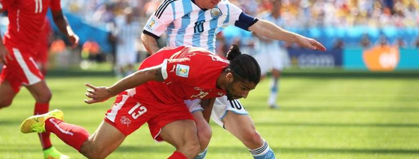 2014 FIFA World Cup - Argentina captain Lionel Messi challenges Switzerland's Ricardo Rodriguez.
