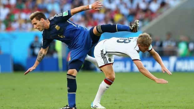 2014 FIFA World Cup - Argentina midfielder Lucas Biglia and Germany midfielder Toni Kroos vie for the ball at the Maracana.