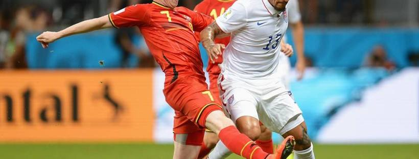 2014 FIFA World Cup - Belgium midfielder Kevin De Bruyne challenges USA midfielder Jermaine Jones.