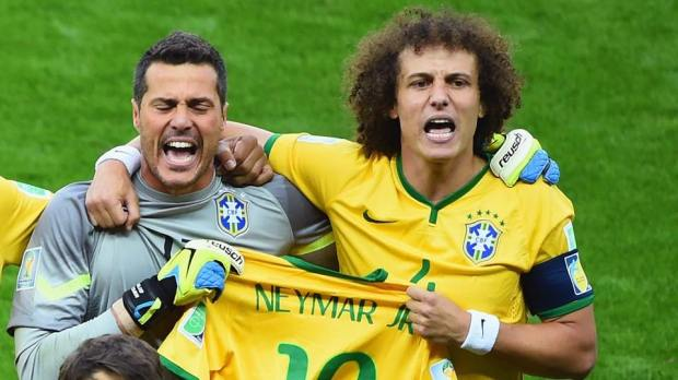 2014 FIFA World Cup - Brazil captain David Luiz and goalkeeper Julio Cesar hold Neymar's shirt during the singing of the national anthem.