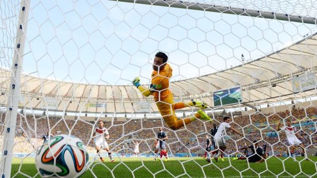 2014 FIFA World Cup - France goalkeeper Hugo Lloris looks on as Hummels heads in the opener.